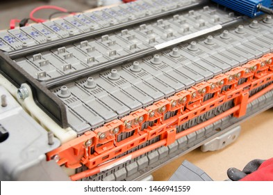 Process of fixing and charging the batteries of the car electric motor in the car service. Disassembling the battery of an electric vehicle engine.