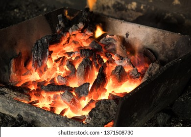 The process of forging metal in the production of heavy molded metal products. Blacksmithing. Pattern and forms for the artist blacksmith. Treatment of molten metal close-up. Handmade blacksmith