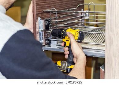 the process of furniture assembly screws closeup
