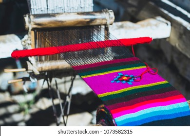The process of  handmade knitting traditional colorful yak wool shawls on the Nepalese tourist souvenir market in Annapurna Conservation Area, Himalaya,  Nepal
