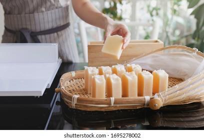 Process handmade soap. Woman cutting handmade soap. Prepare handmade soap for cure soap. Close up. Shampoo bar. - Shutterstock ID 1695278002