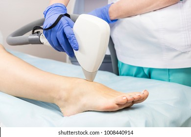 The process of laser depilation of female limbs in the beauty salon