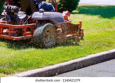 process of lawn mowing, concept of mowing the lawn, lawnmower cutting grass with gardening tools