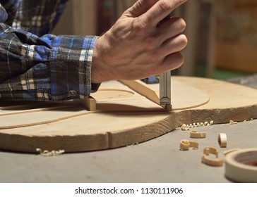 The process of making a classical guitar. Making the right shape of a brace guitar.