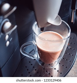 Process of making coffee by coffee machine pour coffee into the cup. Coffe latte. Morning