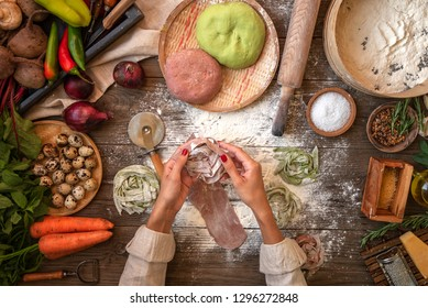 Process of making cooking homemade pasta. Chef make fresh italian traditional pasta. Flat lay. Top view. Frame. Rustic style, toned image.
