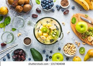 Process of making fruit smoothies, fruits and berries, food background, top view