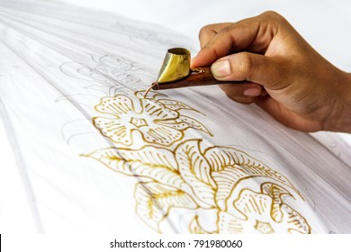 Process of making Indonesian batik. It's a handmade artwork and one of the country's heritage, produced by technique of wax-resist dyeing applied to fabric.