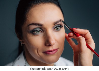 Process of making makeup. Make-up artist working with brush