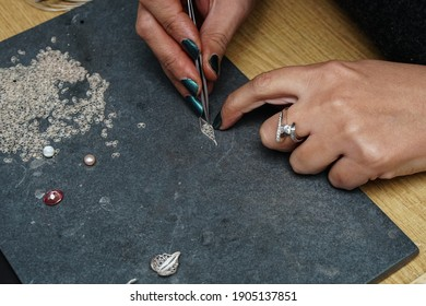 Process of making silver filigree. Production and making manufacturing, factory, cast craft design, process precious silver jewelry, filigree, ring jeweler, silversmith in workshop.