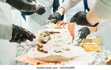 Process of making a sweet dessert cake in the kitchen. Details slicing fruits, hands close-up cream decoration. Culinary school, competition of cooks, pastry chefs, demonstration, lesson, training.