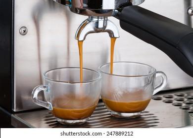 process of making two espresso shots using espresso machine