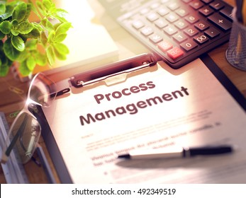 Process Management- Text on Clipboard with Office Supplies on Desk. 3d Rendering. Blurred Toned Illustration.