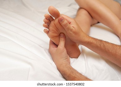 Process of massage on females' foot. A foot of a young woman close up.