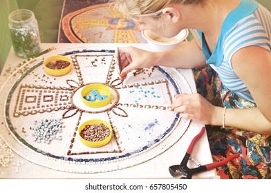Process Of Mosaic Making, Young Blonde Girl Sitting, Holding A Tweezers, Making A Mosaic, Creative Arts Background