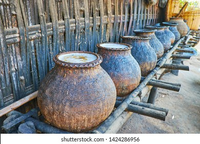 The process of palm sap fermentation in large clay jars to produce Toddy palm wine and brandy in small farmland of Bagan, Myanmar