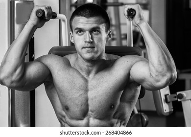 The process of physical exercise . The man is engaged in the gym. Training in the gym. Healthy lifestyle. Photo in creative.