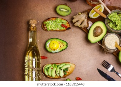 process of preparing a bruschetti with toast avocado, vegetarian food, healthy diet concept. Authentic lifestyle image. copy space, top view.