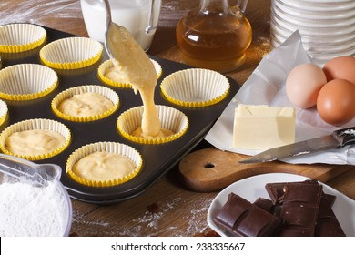 The process of preparing cupcakes in the kitchen, ingredients closeup horizontal