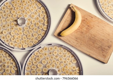 Process of preparing homemade banana slices chips for drying dehydrating on dryer plates