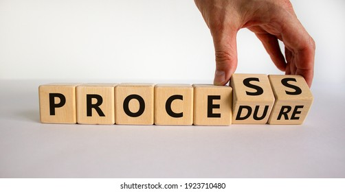 Process or procedure symbol. Businessman turns wooden cubes, changes a word 'process' to 'procedure'. Beautiful white background. Business and process or procedure concept. Copy space.