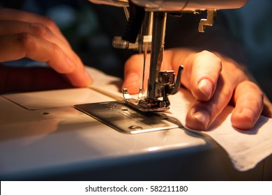 The process of sewing on the sewing machine, close-up.