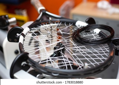 Process of stringing a tennis racket in a tennis shop, sport and leisure concept, maintenance and tunning tennis racket