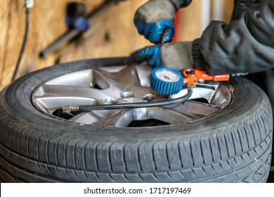 Process of tire repairing. Repair a tire from car by mechanic. Winter tires