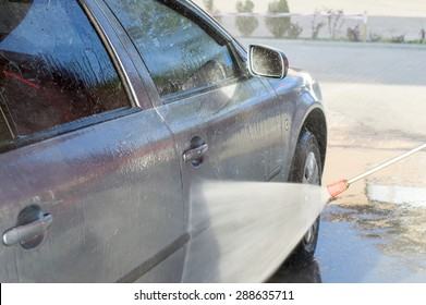 The process of washing the car at the carwash