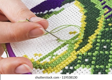The process of working on a piece of embroidery, close-up
