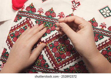 The process of working on a piece of embroidery.Ukrainian towel. Close-up