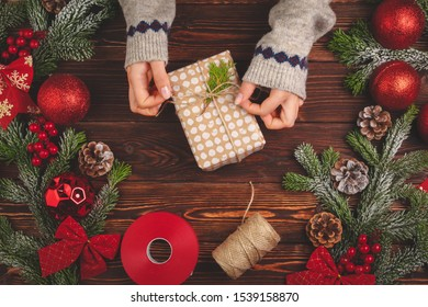Process of wrapping gifts and decorating for Christmas holidays close up