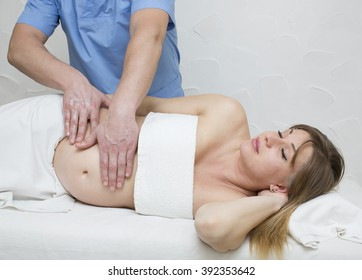 processes salon doing massage to a pregnant woman