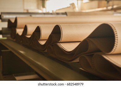 Processing cardboard in a paper mill close-up.