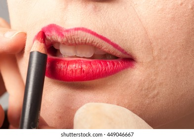 processing make up with a red lipstick
