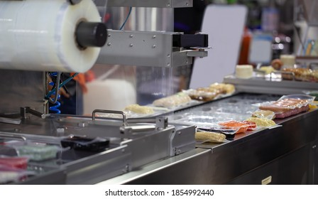 Processing of Packaging of meat ball and sausage on food vacuum packaging sealing machine in food industrial factory