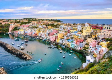 Procida island, Naples, Italy, colorful houses in Marina di Corricella harbour in dramatic sunrise light