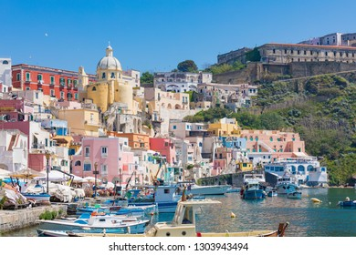 Procida, Italy - April 21, 2018: Colorful housing, cafes and restaurants of Marina Corricella in sunny day, Procida Island, Italy.