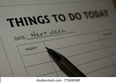 Procrastination concept, pen and notepad with Things To Do Today as title, dated Next Week. New Year to do list.