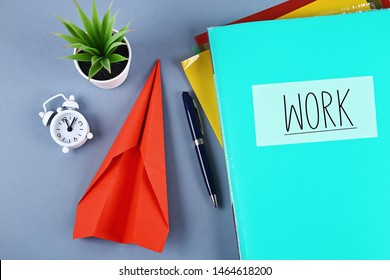 Procrastination, delay and urgency concept. Putting off work to be done. Replacing the work of folding aircraft.