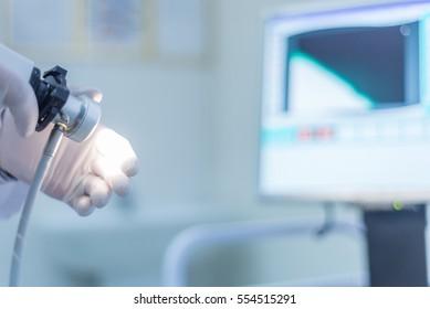 proctologist holding anoscope