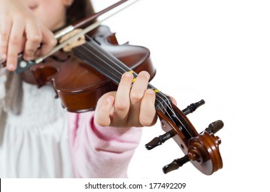 Prodigy playing the violin in the school of music