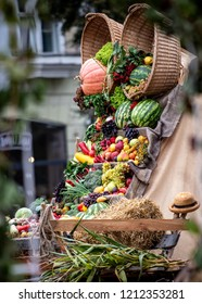 produce display of a multitude of seasonal fruits and vegetables at a harvest festival