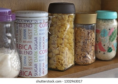 Produce glass jars reused for food storage, standing on a shell in kitchen. Buying food in bulk (plastic free and low-zero waste lifestyle)