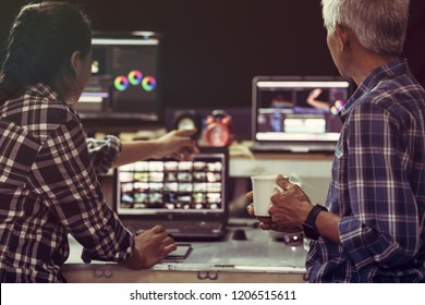 Producer creative senior man and young woman editor working together in filmmaking or Vlog and Present job next project, This is lifestyle of freelance and freedom working.