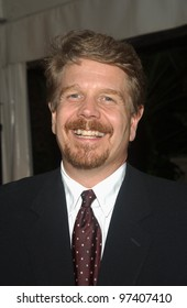 Producer JOHN WELLS at party in Los Angeles to celebrate to 100th episode of TV series The West Wing. November 1, 2003  Paul Smith / Featureflash