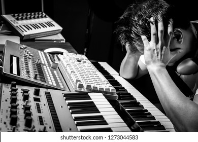 producer, songwriter, composer worried and tense because he couldn't create desired good song