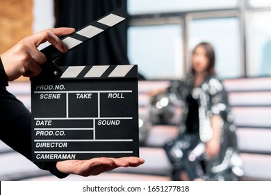 Producing Online Movies and TV Series. Focus On Clapper Board With Woman On Stage On Background. Movie Or Clip Production Backstage