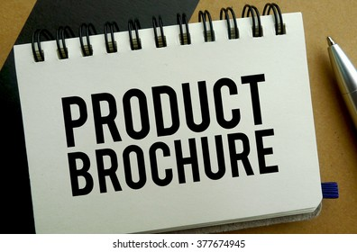 Product brochure memo written on a notebook with pen