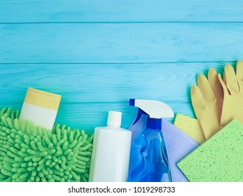 product for cleaning the house on a blue wooden table with copy space